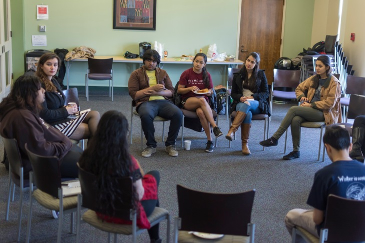 students gather to have tea  and talk about religion and spirituality in a safe space
